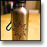 Jessica Williams' Tribal Sun design etched onto a stainless steel water bottle